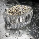 dried lavender flowers in a crystal bowl on stainless steel after rain
