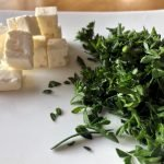 Feta and parsley on a plate