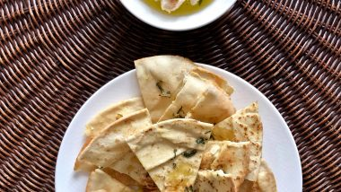 Pita chips with garlicky white bean dip