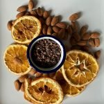 Dehydrated orange slices with cacao and almonds