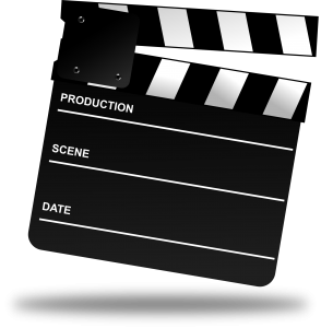 black and white clapperboard used in the movie industry
