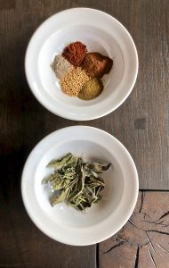Dehydrated herbs and spices in bowls on the table