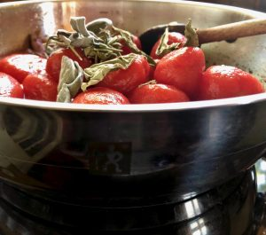dehydrated herbs on top of tomatoes in a pot