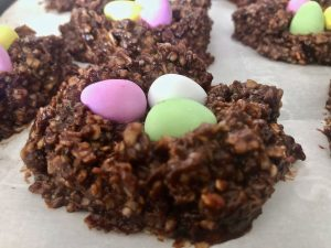 small chocolate eggs ready to bake in the nest