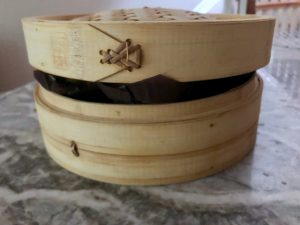 One way to carry hot muffins in a bamboo steamer