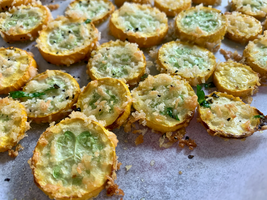 Baked zucchini slices on parchment paper