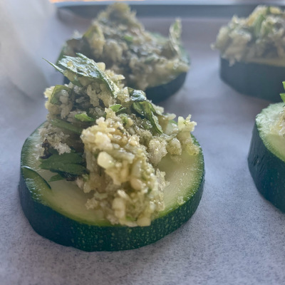 a dollop of pesto on more zucchini slices