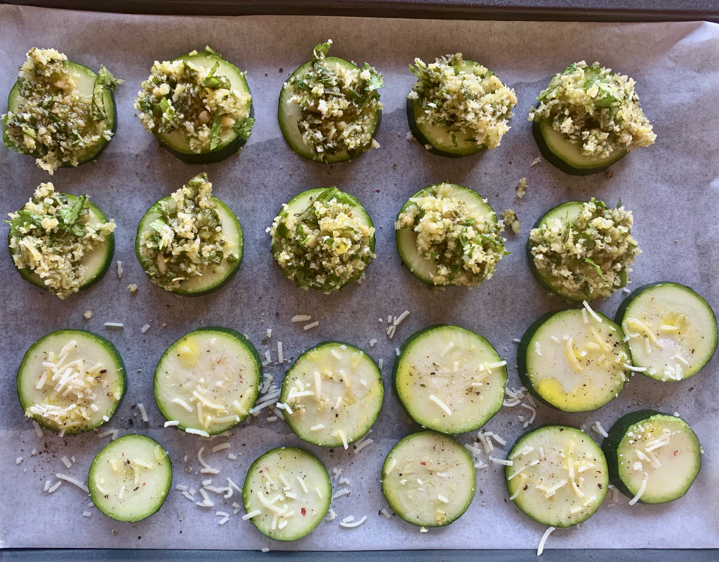 Full tray of zucchini slices prepared to be baked