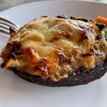 stuffed portobello mushroom on a plate with a fork