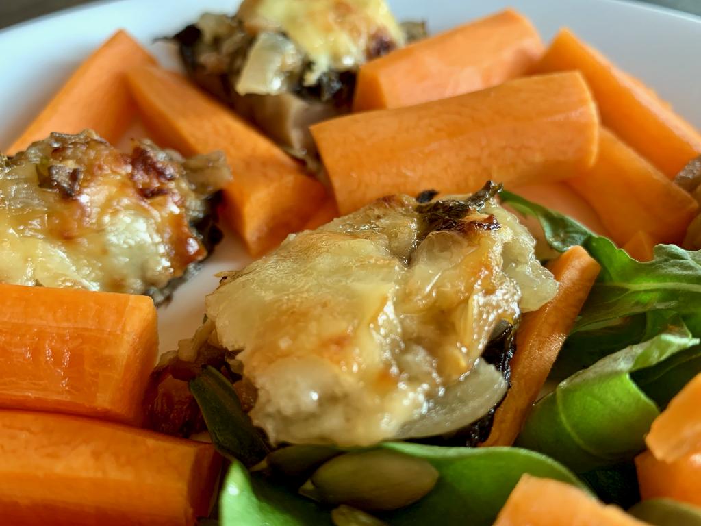 Stuffed mushroom pieces amongst a salad