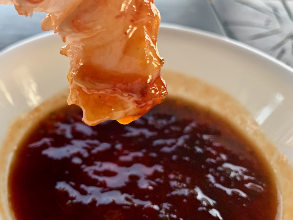 Shrimp dipped into spicy cocktail sauce