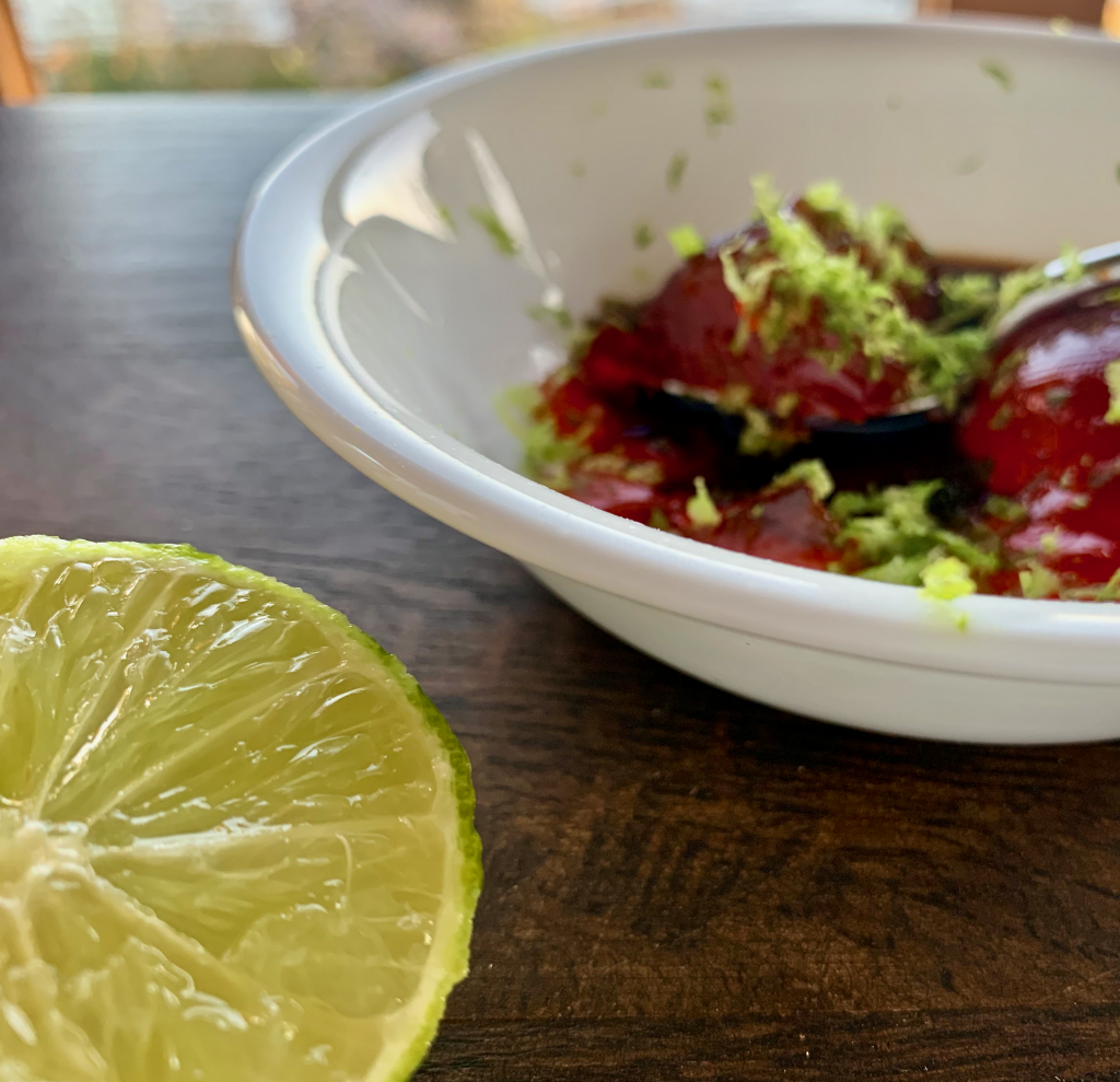 Close up of lime with remaining ingredients in the background
