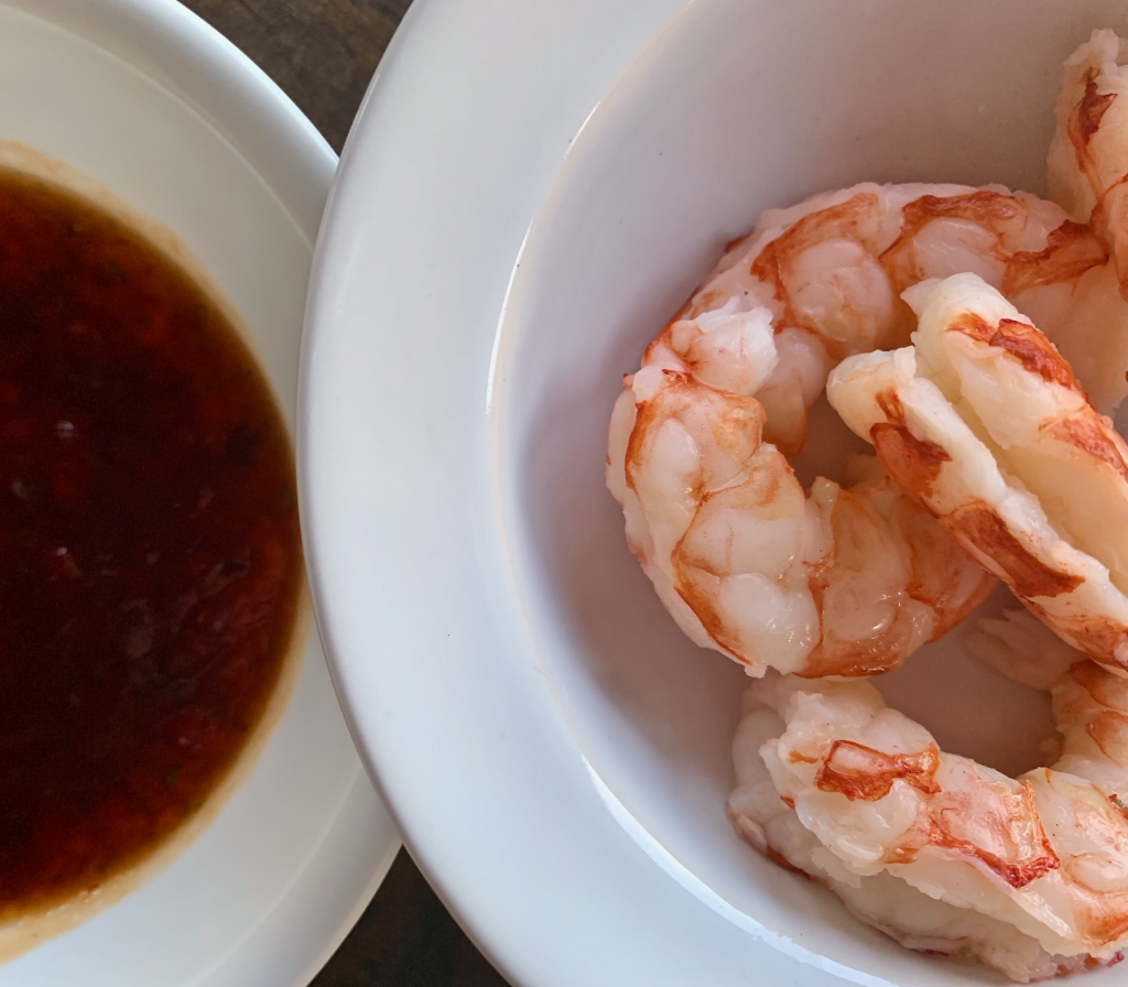 Cooked shrimp and sauce side-by-side