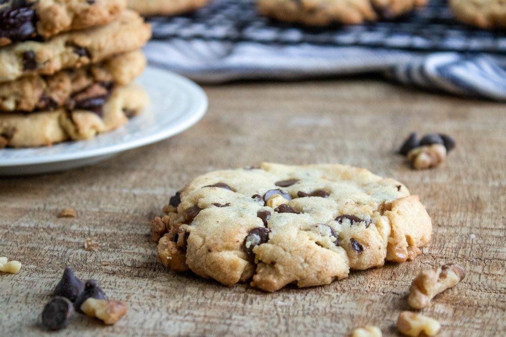 Walnut chocolate chunk cookie on a wood board
