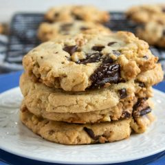 Stacked walnut chocolate cookies on two white and blue plates