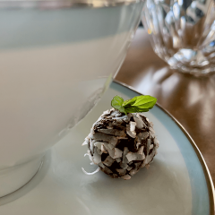 single mint truffle on a china tea cup with a mint leaf