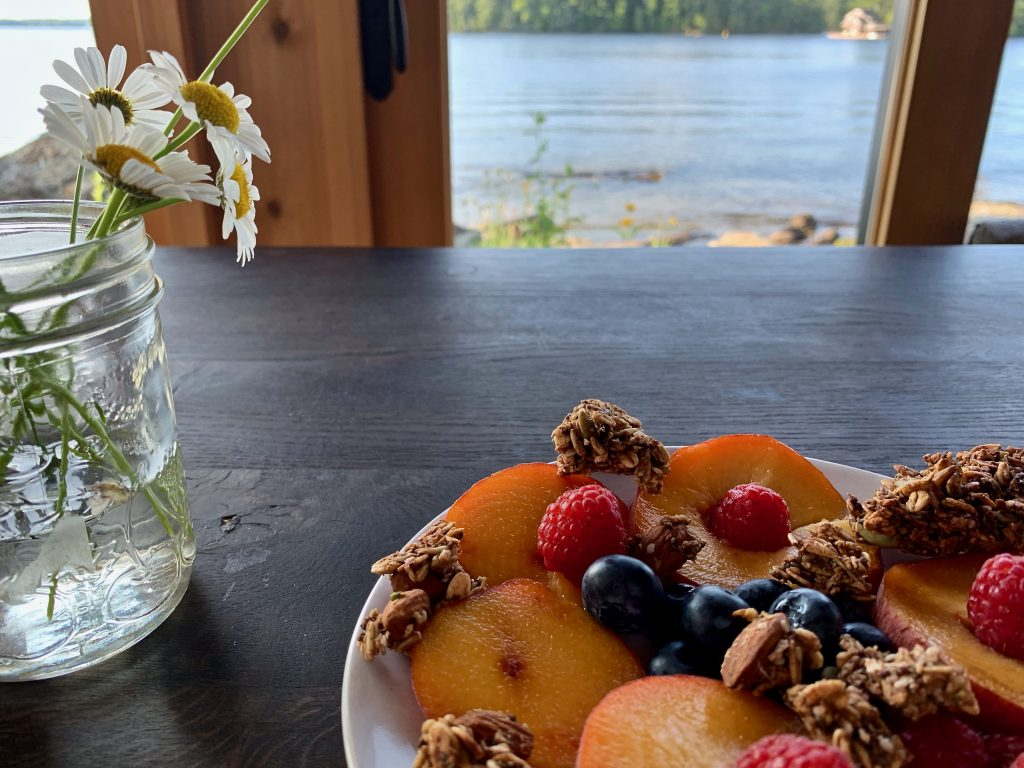 brunch on the table with daisies and water in the background