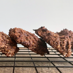 Cookies lined up in a cooling rack