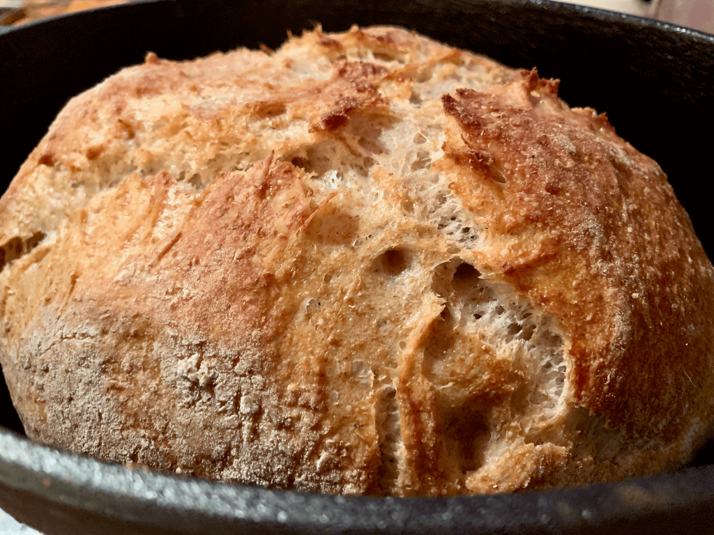 sourdough loaf in a cast iron dutch oven