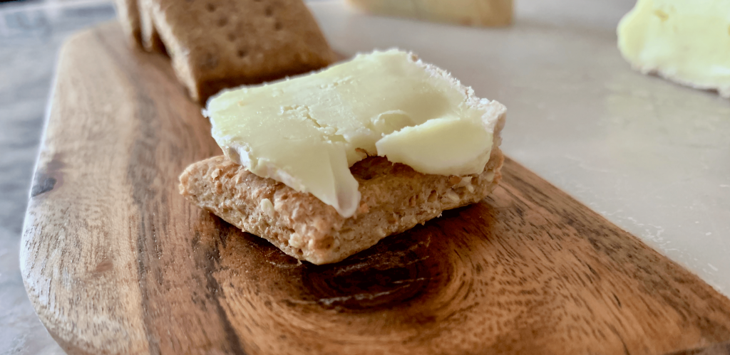 soft cheese on a cracker