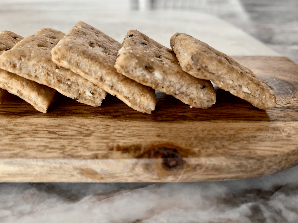 Tirokafteri sourdough crackers on a wood and marble cheeseboard