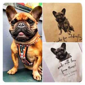 photo of a french bulldog with his likeness on gift bags