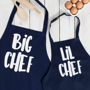 Matching adult and child navy blue aprons