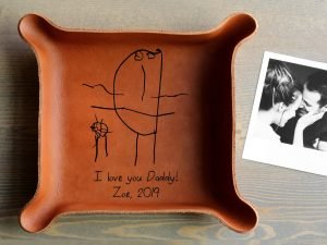 Leather tray with child's note and sketch inside