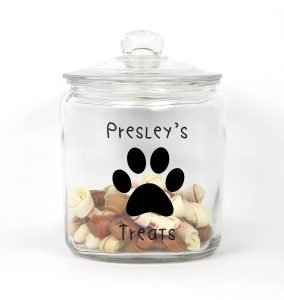 Dog treat jar with dog's name and a paw print outside