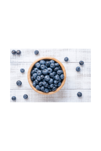 Birds eye view of blueberries in a bowl with some scattered on a wood board