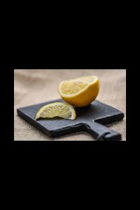 Lemon cut up on a board