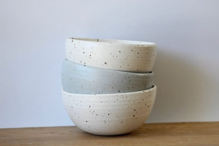 3 stacked speckled bowls in cream and blue
