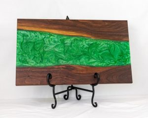 Charcuterie board in black walnut wood wth a green swirl through the centre