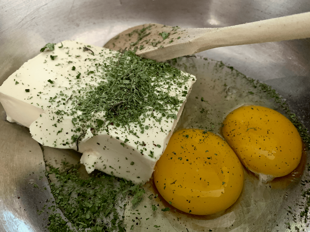 Add eggs, cream cheese, and oregano to a large mixing bowl
