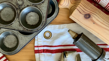 Birds-eye view of kitchen equipment on red and white tea towels