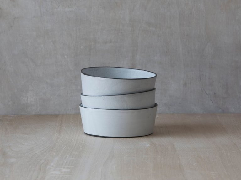 3 modern ceramic bowls stacked 3 high
