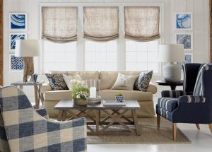 Linen Roman shades gently cover windows