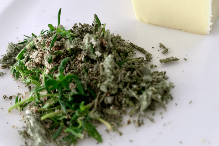 Herbs chopped, crushed, and seasoned before adding to butter