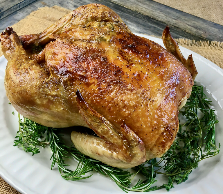 Garlic and herb roasted chicken makes a simple, easy meal served on a bed of fresh herbs for extra fragrance.