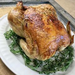 Garlic Herb Roasted chicken served with fresh herbs