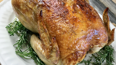 Garlic Herb Roasted chicken served with fresh herbs