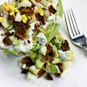 Tasty homemade blue cheese dressing with the crunch of bacon go well together with soft, ripe avocado
