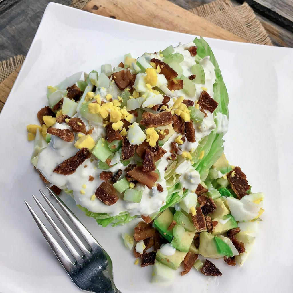 Wedge salad drizzled with homemade blue cheese dressing and garnished just before serving
