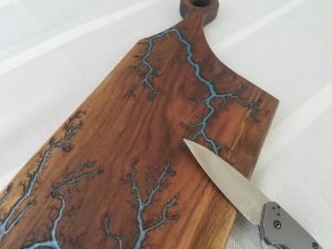 One of a kind walnut wood boards with a resin imbedded in