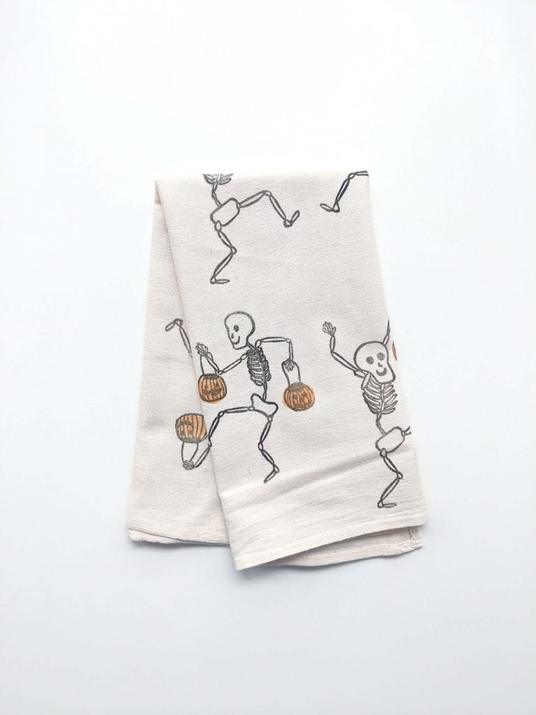 Halloween tea towels with dancing skeletons and pumpkins make your kitchen feel festive