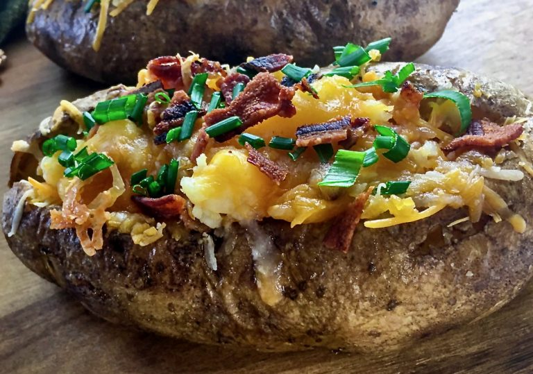 Loaded stuffed potatoes before sour cream