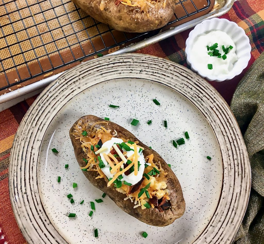 Loaded Stuffed Baked Potato with sour cream dressing
