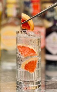 Paloma cocktail with grapefruit chunks give a more casual look