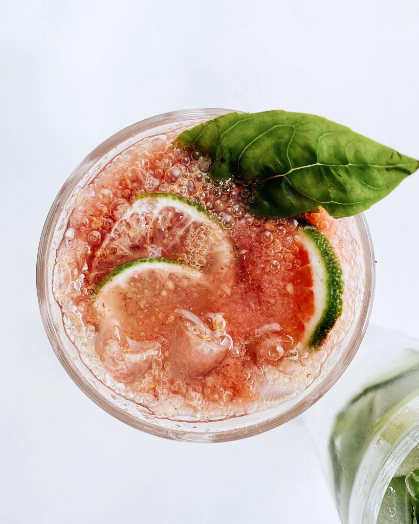 Paloma cocktail garnished with a basil leaf for a new twist on flavours
