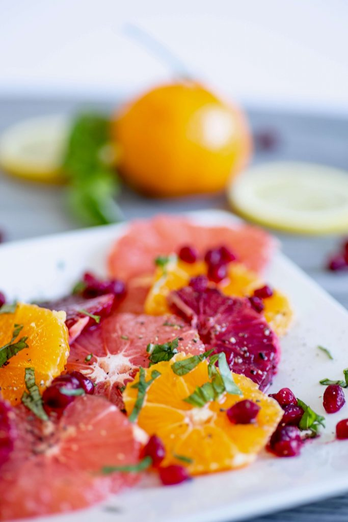 Citrus salad with red grapefruit slices go well with a Paloma cocktail